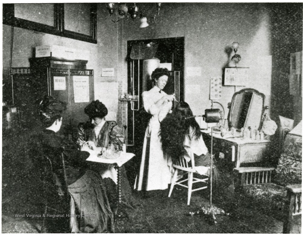 Women are doing hair and nails in the parlor.