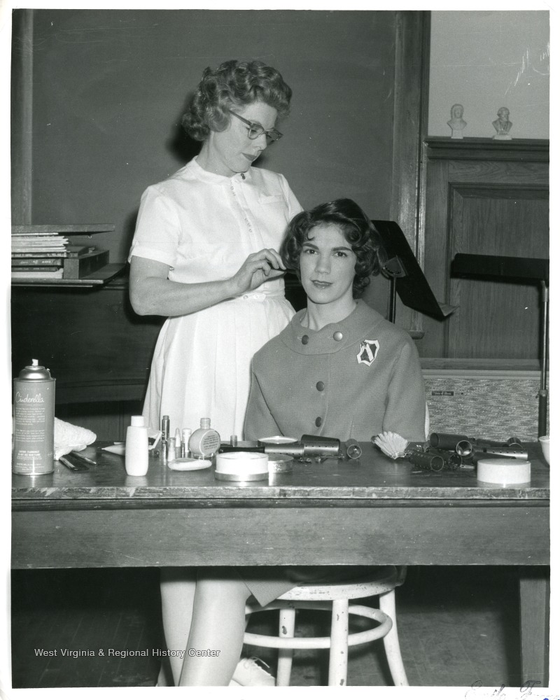 Patty Watson is getting her hair done at a Hairdresser's Shop.