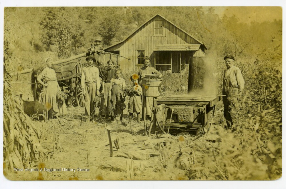 'Asberry Jackson Mayfield (1846-1927) at far right and family making molasses outside their home in Wetzel County, West Virginia.'